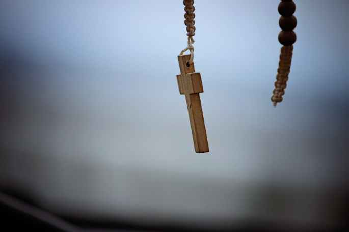 beads blur catholic close up